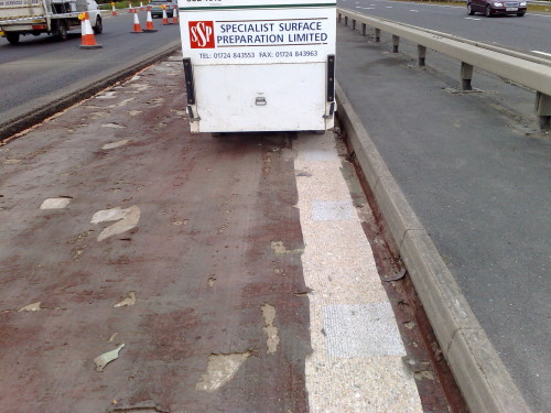 Work begins on bridge surface preparation